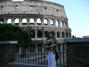 Gillian Lewis: Spectrum wearing Rohan White Linen Trousers in front of the Colliseum, Rome